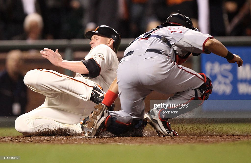 Aubrey Huff #17 of the San Francisco Giants slides home past Ivan Rodriguez #7 of the Washington Nationals on a single by Nate Schierholtz during an MLB game at AT&T Park on June 6, 2011 in San Francisco, California.