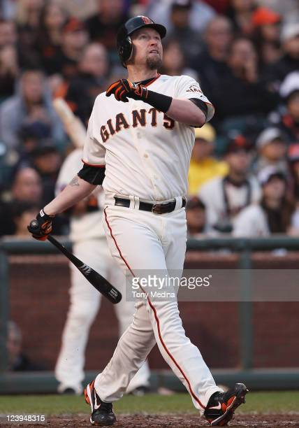 Aubrey Huff of the San Francisco Giants watches a ball that he hit during a game against the Arizona Diamondbacks at ATT Park on September 3 2011 in...