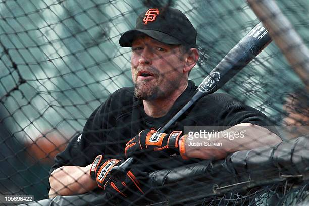 Aubrey Huff of the San Francisco Giants watches batting practice before Game Three of the NLCS during the 2010 MLB Playoffs against the Philadelphia...