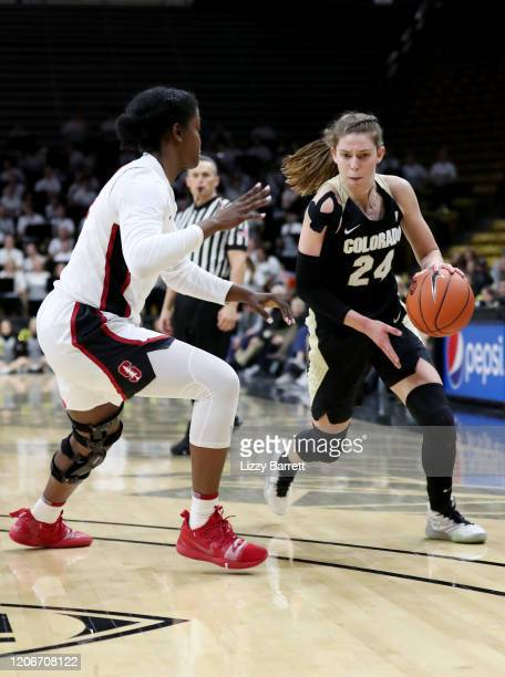 Aubrey Knight of the Colorado Buffaloes dribbles past the defense of Nadia Fingall of the Stanford Cardinal during the third quarter of a game at...