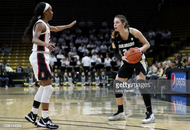 Aubrey Knight of the Colorado Buffaloes looks past the defense of Kiana Williams of the Stanford Cardinal during the third quarter of a game between...