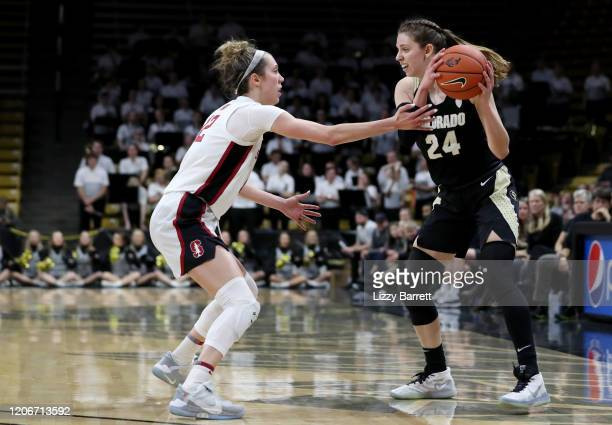 Aubrey Knight of the Colorado Buffaloes looks to pass away from the defense of Lexie Hull of the Stanford Cardinal during the fourth quarter of a...