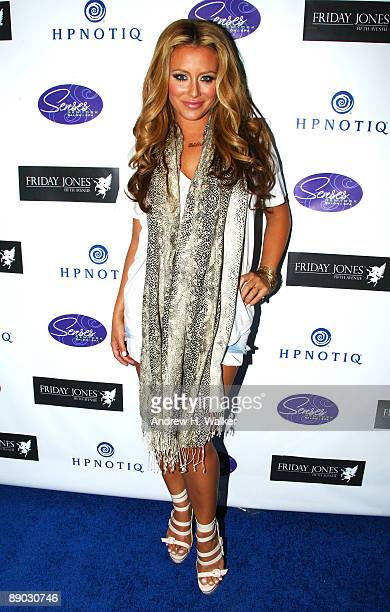 Aubrey O'Day attends the opening of Friday Jones Fifth Ave Tattoo Studio at Senses NY Salon Spa on July 14 2009 in New York City