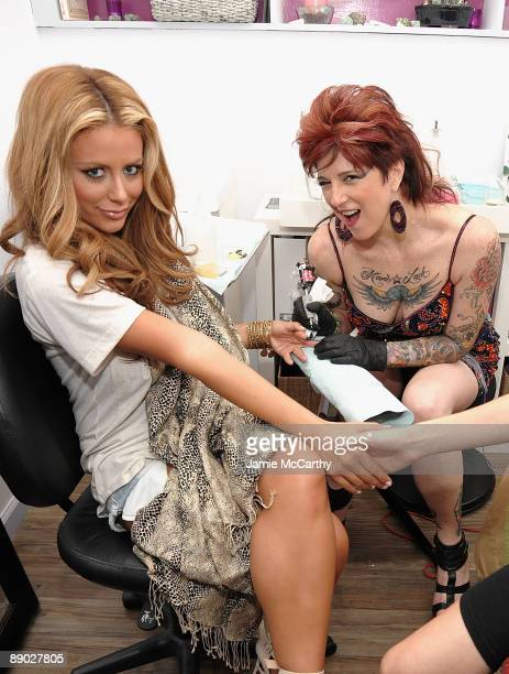 Aubrey O'Day get a tattoo from Tattoo Artist Friday Jones at the opening of Friday Jones Fifth Ave Tattoo Studio at Senses NY Salon Spa on July 14...