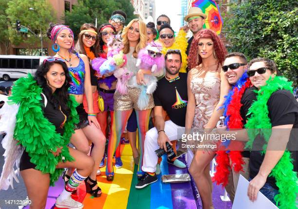 "Aubrey O'Day holding her dogs Ginger and Mary Ann appears on the Virgin America ""Ride With Pride"" Float at the Gay Pride Parade on June 24, 2012 in..."