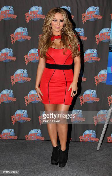 """Aubrey O'Day promotes her Oxygen Network series """"All About Aubrey"""" as she visits Planet Hollywood Times Square on March 7, 2011 in New York City."""