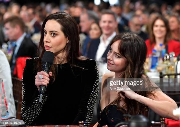 Aubrey Plaza and Dakota Johnson speak during the 2019 Film Independent Spirit Awards on February 23 2019 in Santa Monica California