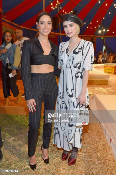 Aubrey Plaza and Emma Roberts attends the Moschino Spring/Summer 19 Menswear and Women's Resort Collection at Los Angeles Equestrian Center on June 8...