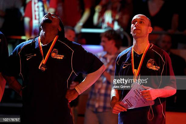 Aubrey Reese and Pascal Roller of Frankfurt react during the award ceremony for Brose Baskets Bamberg after they have won the German Championship by...