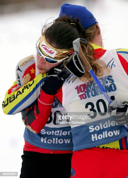 Aubrey Smith and Caitlin Compton embrace at the finish line in the 10K Classic event January 7 2006 during the US Cross Country Championships at...