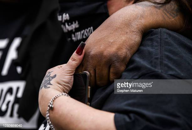 Aubrey Wright and Katie Wright hold hands at a memorial for their son, Daunte Wright, on May 2, 2021 in Brooklyn Center, Minnesota. Twenty-year-old...