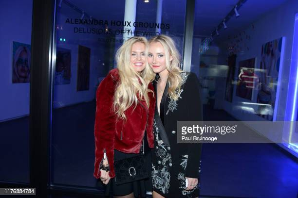 Aubrie Wienholt and Alexandra Houx Grounds attend Delusions of the Wild Solo Exhibition By Alexandra Houx Grounds at 213 Bowery on October 17 2019 in...