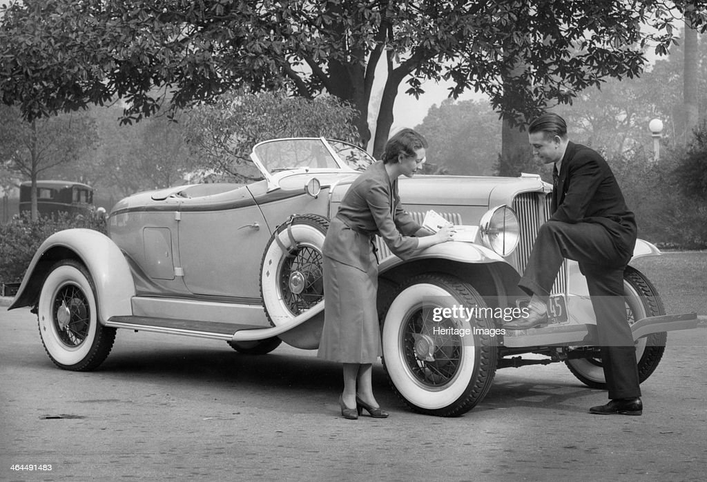 Auburn car, (c1930s?). From 1925, under EL Cord's direction, Auburn cars gained a reputation for luxury, style and performance. The woman in the picture appears to be writing a cheque too pay for the car.