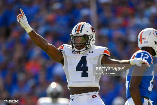 Auburn defensive back Noah Igbinoghene celebrates a pass breakup during the first half of a college football game between the Florida Gators and the...