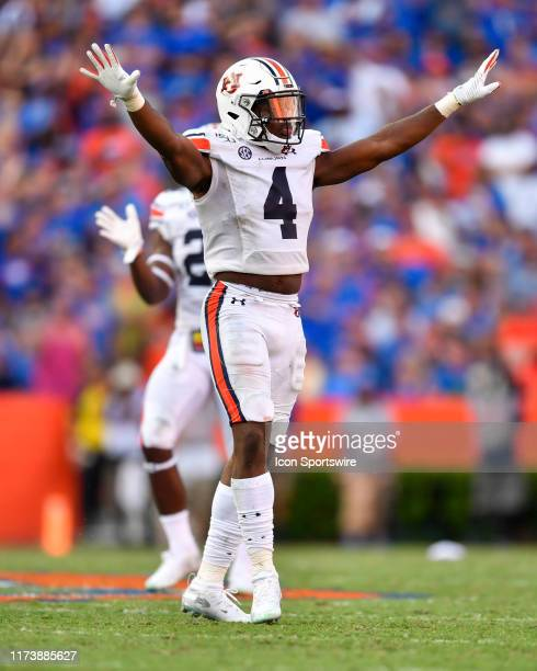 Auburn defensive back Noah Igbinoghene celebrates breaking up a pass during the second half of a college football game between the Florida Gators and...