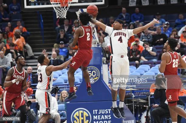 Auburn forward Chuma Okeke tries to block a shot by Alabama guard Collin Sexton during a Southeastern Conference Basketball Tournament game between...