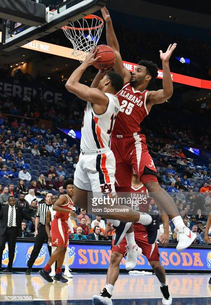 Auburn forward Daniel Purifoy goes up for a shot with Alabama forward Braxton Key defending during a Southeastern Conference Basketball Tournament...