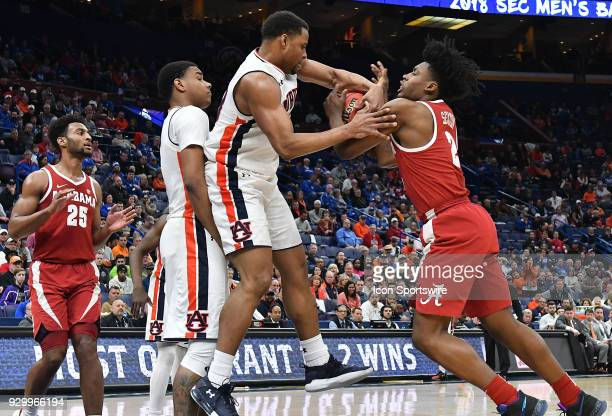 Auburn forward Desean Murray and Alabama forward Braxton Key battle for a rebound during a Southeastern Conference Basketball Tournament game between...