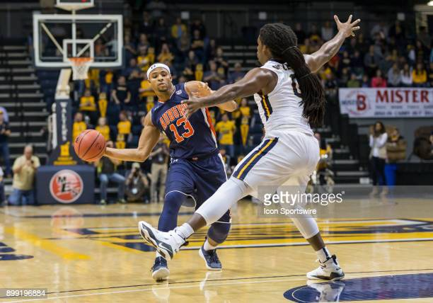 Auburn forward Desean Murray makes a pass while being guarded by Murray State forward Terrell Miller Jr during the college basketball game between...