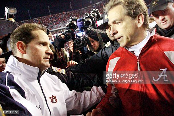 Auburn head coach Gene Chizik left and Alabama head coach Nick Saban shake hands following the Auburn's 2821 win in the Iron Bowl at BryantDenny...