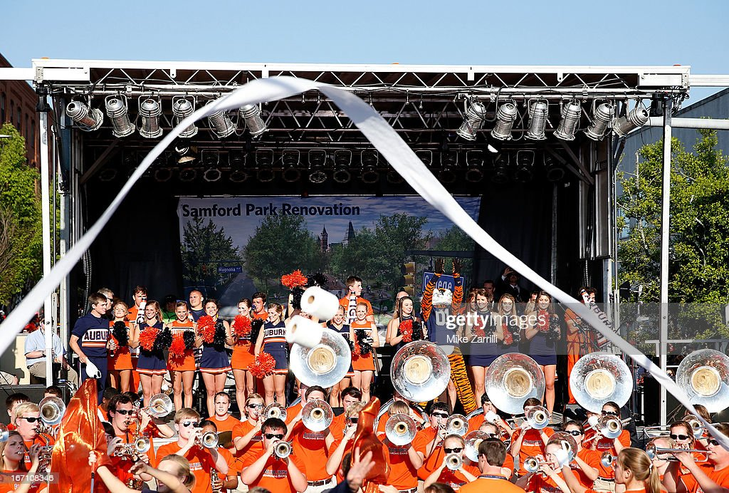 Auburn mascot Aubie and the Auburn University cheerleaders and band perform during the Auburn Oaks at Toomer's Corner Celebration on April 20, 2013 in Auburn, Alabama.