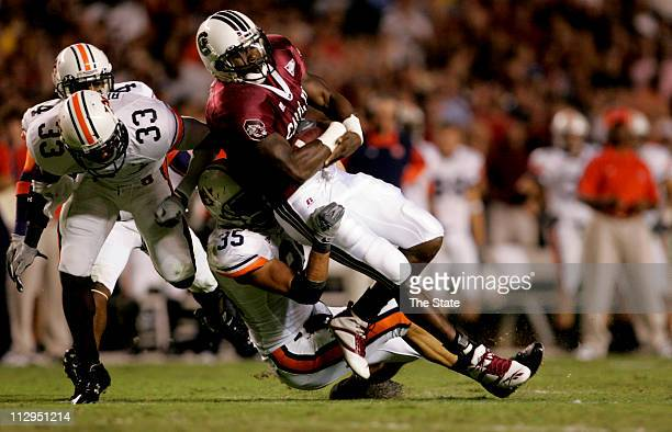Auburn outside linebacker Will Herring tries to bring down South Carolina running back Cory Boyd as he rushes for a first down in the first quarter...