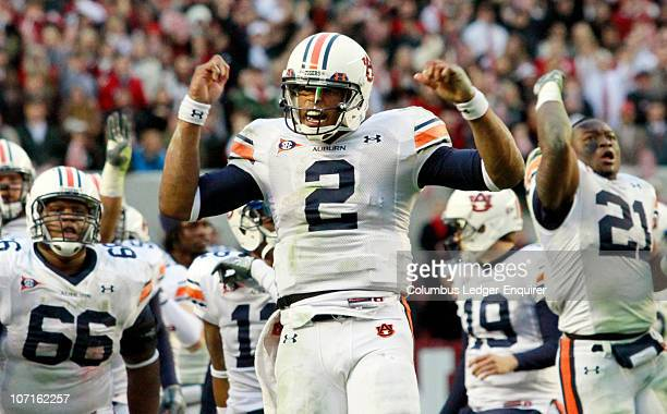 Auburn quarterback Cam Newton helps fire up his team prior to the start of the fourth quarter against Alabama at Bryant-Denny Stadium in Tuscaloosa,...