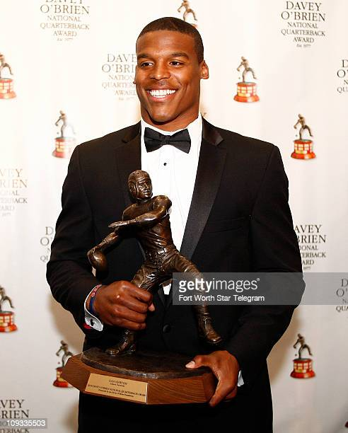 Auburn quarterback Cam Newton speaks at a press conference after being awarded with the winner of the 2010 Davey O'Brien Award at the Fort Worth Club...