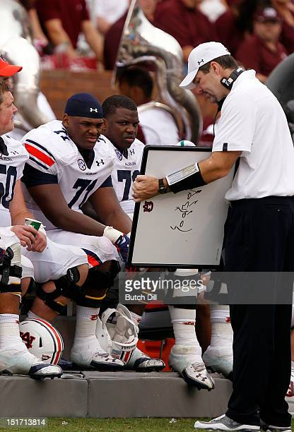 Auburn Tiger players get instruction from a coach in the fourth quarter of a NCAA college football game against the Mississippi State Bulldogs on...
