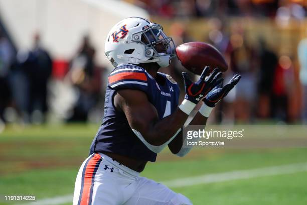 Auburn Tigers defensive back Noah Igbinoghene returns a kick off during the Outback Bowl between the Auburn Tigers and Minnesota Golden Gophers on...