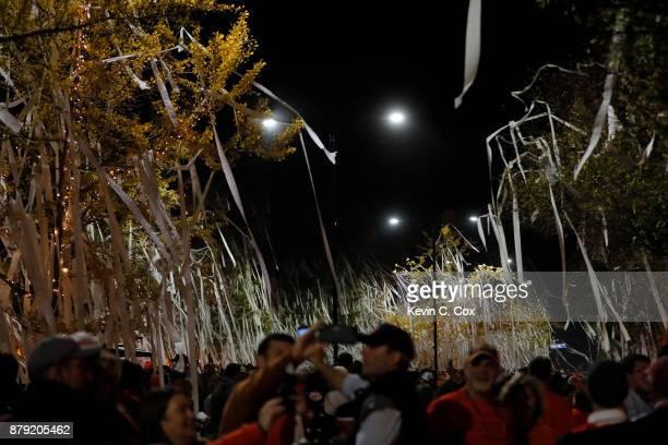Auburn Tigers fans celebrate at Toomer's Corner after the Iron Bowl victory over the Alabama Crimson Tide at Jordan Hare Stadium on November 25 2017...