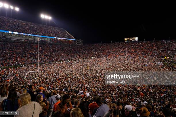 Auburn Tigers fans storm the field in celebration after the victory over the Alabama Crimson Tide at Jordan Hare Stadium on November 25 2017 in...