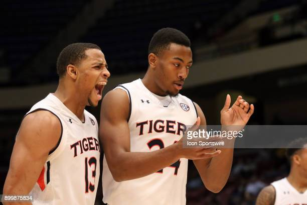 Auburn Tigers forward Desean Murray and Auburn Tigers forward Anfernee McLemore react to a play in the game between the Middle Tennessee Blue Raiders...