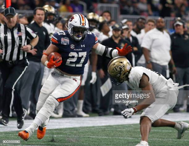 Auburn Tigers fullback Chandler Cox tries to avoid a UCF defender during the ChickfilA Peach Bowl between the UCF Knights and the Auburn War Eagles...
