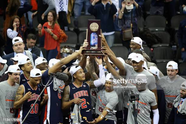 Auburn Tigers guard Bryce Brown and his teammates hold up the Midwest Regional trophy after defeating the Kentucky Wildcats 7771 in overtime in the...