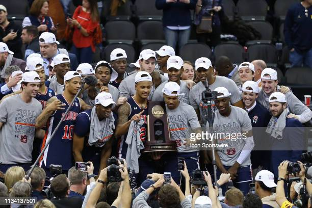 Auburn Tigers guard Bryce Brown and teammates hold up the Midwest Regional trophy after defeating the Kentucky Wildcats 7771 in the the NCAA Midwest...