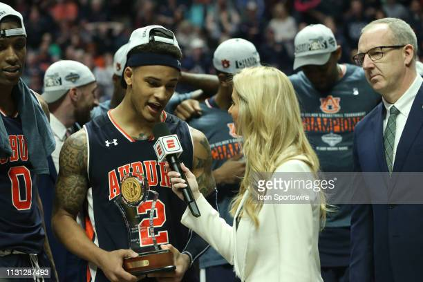 Auburn Tigers guard Bryce Brown being interviewed by ESPN reporter Laura Rutledge after being awarded the MVP trophy in the Southeastern Conference...