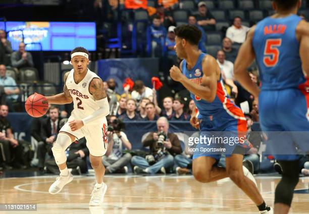 Auburn Tigers guard Bryce Brown brings the ball down the floor during a Southeastern Conference Tournament semifinal game between the Florida Gators...