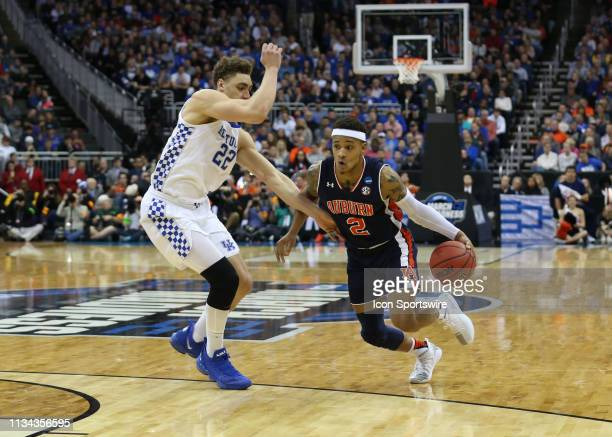 Auburn Tigers guard Bryce Brown drives past Kentucky Wildcats forward Reid Travis in the first half of the NCAA Midwest Regional Final game between...