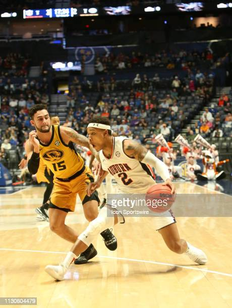 Auburn Tigers guard Bryce Brown drives past Missouri Tigers guard Jordan Geist during a Southeastern Conference Tournament game between the Missouri...