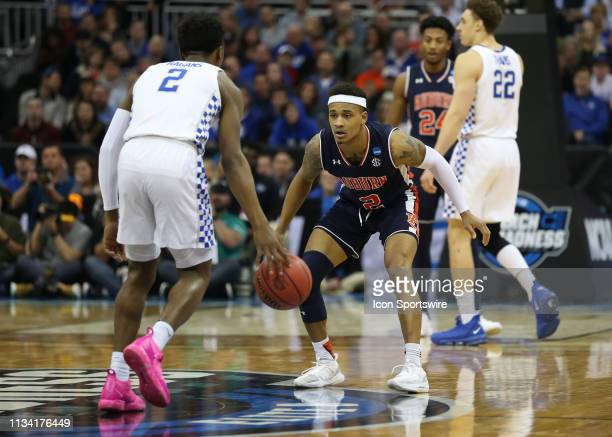 Auburn Tigers guard Bryce Brown gets low to guard Kentucky Wildcats guard Ashton Hagans in the second half of the NCAA Midwest Regional Final game...