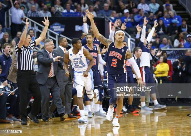 Auburn Tigers guard Bryce Brown holds up three fingers in celebration after making a three early in the second half of an NCAA Midwest Regional Sweet...