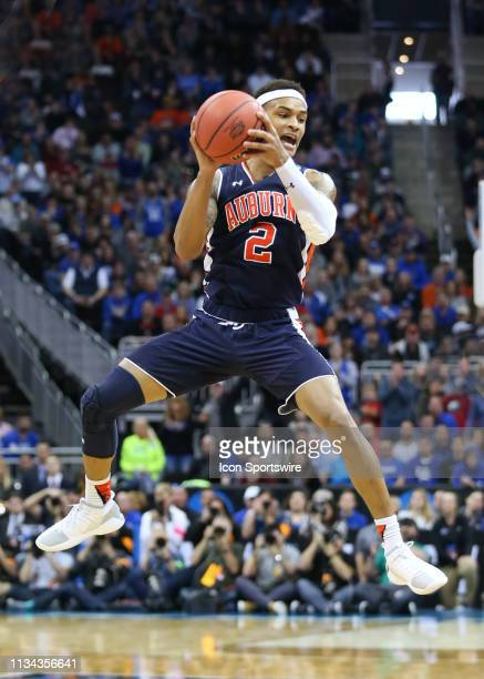 Auburn Tigers guard Bryce Brown jumps as he looks to pass in the second half of the NCAA Midwest Regional Final game between the Auburn Tigers and...