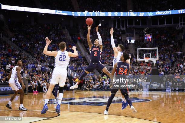 Auburn Tigers guard Bryce Brown legs split out wide as he shoots and makes a three with 1747 left in the second half of the NCAA Midwest Regional...