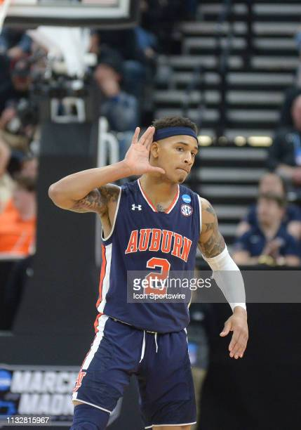 Auburn Tigers guard Bryce Brown reacts after hitting a three during a game between the Auburn Tigers and the Kansas Jayhawks on March 23 2019 at...