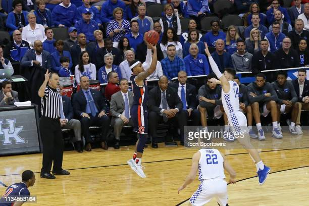 Auburn Tigers guard Bryce Brown shoots a three over Kentucky Wildcats guard Tyler Herro in the first half of the NCAA Midwest Regional Final game...