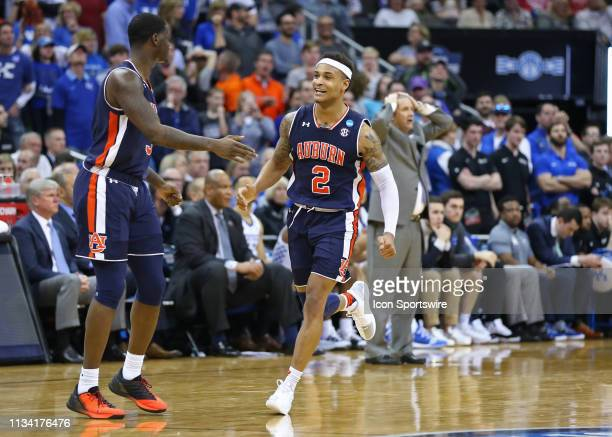 Auburn Tigers guard Bryce Brown smiles as Kentucky Wildcats head coach John Calipari holds his head on the background in the final seconds of...