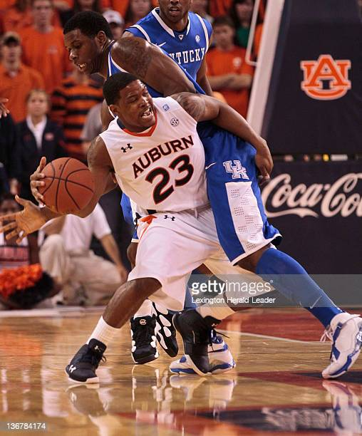 Auburn Tigers guard Frankie Sullivan tried to get around Kentucky Wildcats forward Terrence Jones during a men's college basketball game on Wednesday...
