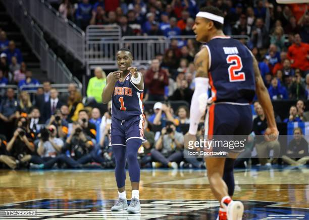 Auburn Tigers guard Jared Harper points to teammate Bryce Brown after Harper made a steal and assisted Brown on a three point shot with 1834 left in...