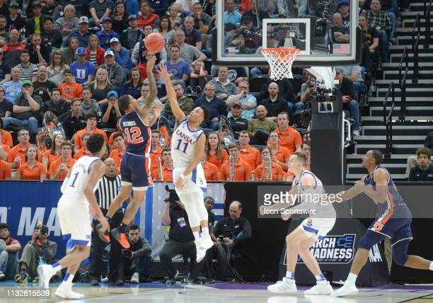 Auburn Tigers guard J'Von McCormick shoots over Kansas Jayhawks guard Devon Dotson during a game between the Auburn Tigers and the Kansas Jayhawks on...